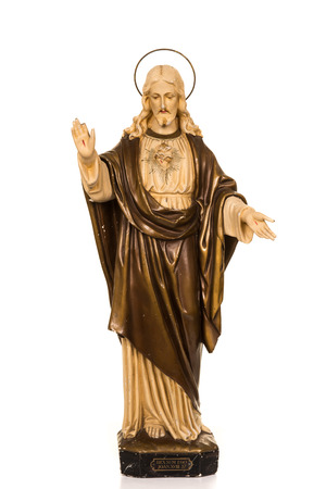 Pretty antique statue of Jesus Christ isolated on a white background