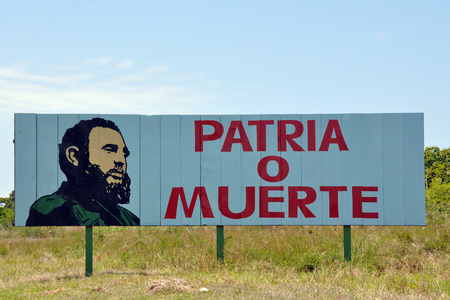 Cuban road advertising board stating patriotism or death