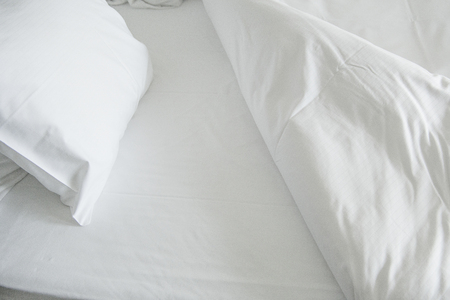 White clean sheets and pillow inviting to go to bed 版權商用圖片