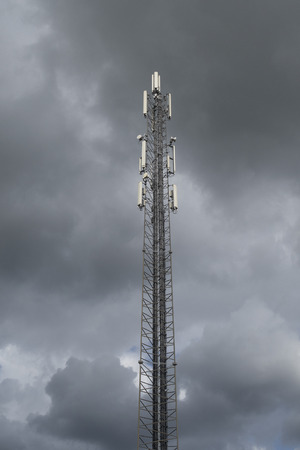 Telecommunication mast for signals for telephone with a clouded threatening sky Banco de Imagens