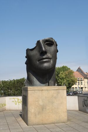 Bamberg, Germany - July 15, 2019; Statue Centurion I, from Igor Mitoraj on the lower bridge in Bamberg, Germany on a blue sky