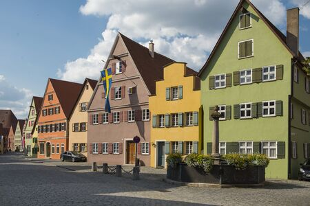 Dinkelsb hl, Bavaria, Germany - July 15, 2019; Colorful houses in a street in Dinkelsb?hl an touristic town on the romantic road