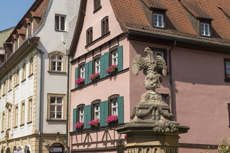 Bamberg, Germany - July 14, 2019; Old half timbered houses and an eagle statue in the center of the city of Bamberg, Germany