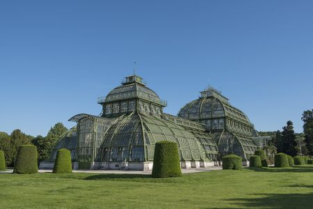 Vienna, Austria - June 3, 2019; The Palm House in the garden of Sch?nbrunn Palace, the largest Palm House on the European continent on a blue sky
