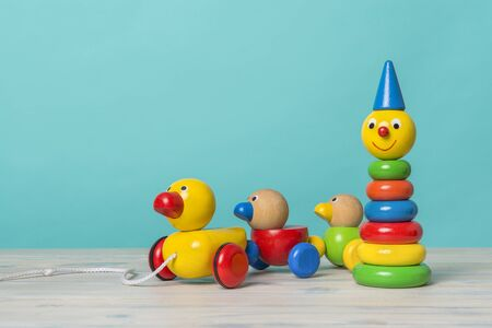 Colorful wooden toys against a blue background with space for copy Stockfoto