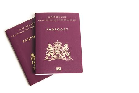 Two closed european passports from the Netherlands lying on a white background Stockfoto