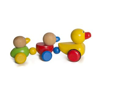 Wooden toy ducks a kids toy to pull around isolated on a white background