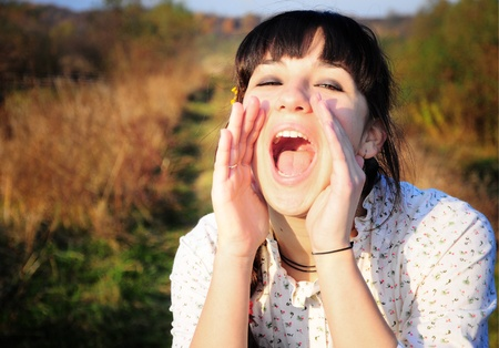 Young woman screaming of joy