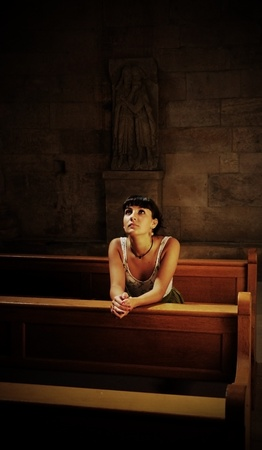 Teen girl praying in the church photo