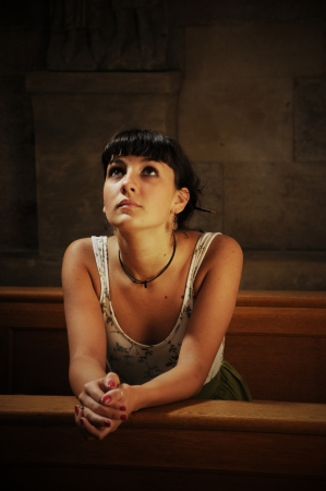 Teen girl praying in the church