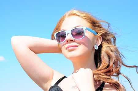 Beautiful young woman smiling in the sun