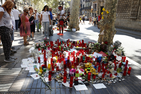 BARCELONASPAIN - 21 AUGUST 2017: People reunited on Barcelonas Rambla, where 17th of August 2017 has been a terrorist attack, giving tribute to the at least 15 fatal victims and over 120 injured