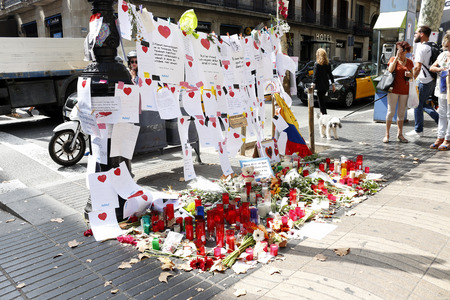 BARCELONA/SPAIN - 21 AUGUST 2017: People reunited on Barcelona's Rambla, where 17th of August 2017 has been a terrorist attack, giving tribute to the at least 15 fatal victims and over 120 injured