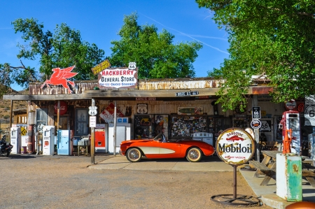 petrol station: Antique General Store in Arizona on Route 66 with Vintage Fuel Pumps and a Retro Car