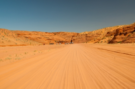 unpaved road: Unpaved road to Upper Antelope Canyon, Page, Arizona within the Navajo Indian Reservation on a hot summer day