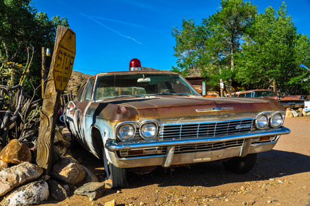 A vintage car with a siren left abandoned near the Hackberry General Store  Hackberry General Store is famous stop on the historic Route 66