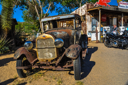 rusty car: A vintage car left abandoned near the Hackberry General Store  Hackberry General Store is famous stop on the historic Route 66