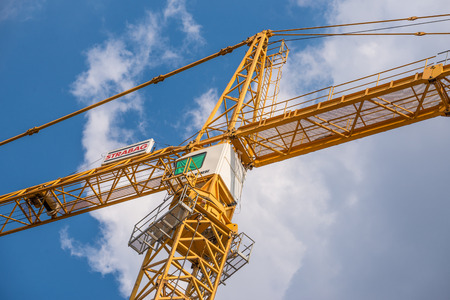 construction companies: VIENNA, AUSTRIA - JULY 17, 2014  Crane of the company  STRABAG  at a construction site  STRABAG is the largest construction company in Austria and one of the largest construction companies in Europe