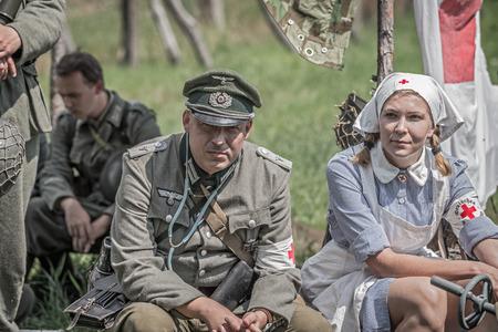 world war ii: TEKOV, SLOVAKIA - JULY 26,2014: German lieutenant and a nurse on a pause during reenactment of World War II fights in Slovakia Editorial