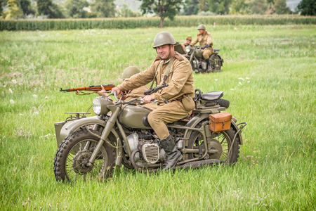 STARY TEKOV, SLOVAKIA - JULY 26,2014:  Soviet soldiers riding sidecars to attack germans during reenactment of World War II in Slovakia