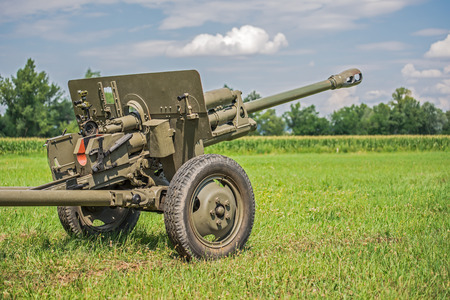 battleground: Cannon from World War II  on a battlefield