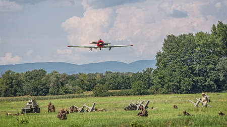 TEKOV, SLOVAKIA - JULY 26,2014:  Russian Yak bomber approaching the battlefield during reconstruction of a World War II fight between Red army and German army.