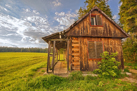 Discarded wooden cabin  in the wilderness. Hdr image.