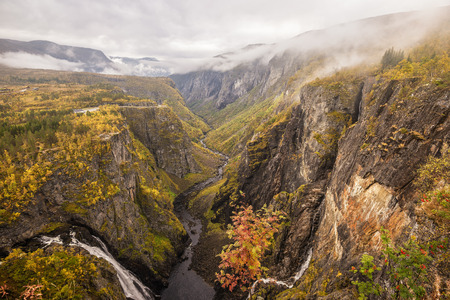national parks: Mabodalen valley and waterfall Voringfossen situated betwen Hardangervidda and Hardangerfjord National Parks,  in the municipality of Eidfjord, Norway Stock Photo