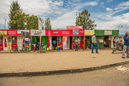 NAIVASHA, KENYA - OCTOBER 18, 2014: Typical shopping street scene with pedestrians in Naivasha, Kenya