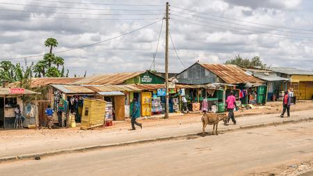 rift: NAMANGA, KENYA - OCTOBER 20, 2014 : Shopping street in Namanga. Namanga is a town lying on the border between Kenya and Tanzania in Kajiado District, Rift Valley Province. Editorial