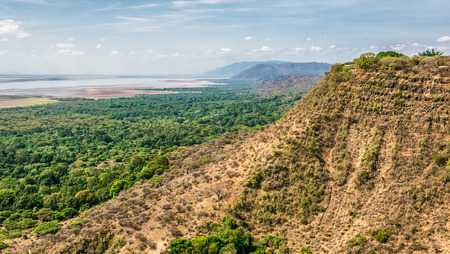 crater highlands: View over  Ngorongoro  Conservation Area with lake Magadi in Tanzania, East Africa. Ngorongoro Crater is a large volcanic caldera and a wildlife reserve.