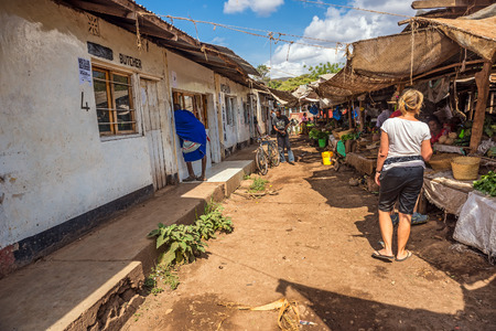 in wa: MTO WA MBU, ARUSHA, TANZANIA - OCTOBER 22, 2014 : People at the local marketplace of Mto Wa Mbu. Mto wa Mbu is an administrative ward in the Monduli district of the Arusha Region of Tanzania Editorial