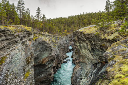 jotunheimen national park: Ridderspranget (The Knight's leap) in Jotunheimen National Park, Norway. Ridderspranget is a current in the river Sjoa formed when the river has gnawed deep into bedrock. Stock Photo