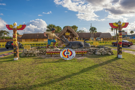 federally: MIAMI, FLORIDA - JANUARY 13, 2015 : Entry to the Miccosukee Indian Village. The Miccosukee Tribe is a federally recognized Indian Tribe residing in the Florida Everglades west of Miami.