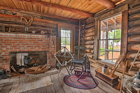 pinellas: LARGO, FLORIDA - JANUARY 14, 2015 : Interior of the historic McMullen-Coachman Log House in the Pinellas County Heritage Village. It is a typical Florida Cracker log home of the pioneer period.