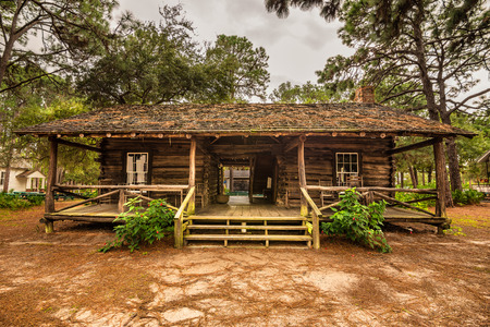 pinellas: LARGO, FLORIDA - JANUARY 14, 2015 : McMullen-Coachman Log House in the Pinellas County Heritage Village. It is a typical Florida Cracker log home of the pioneer period.