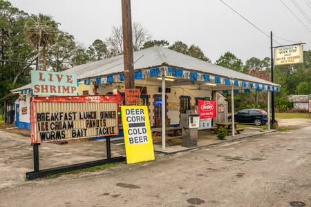 levy: OTTER CREEK, FLORIDA - JANUARY 15, 2015 : Vintage gas pump and a general store on US Highway 19, near Cedar Key, Florida