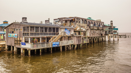 CEDAR KEY, FLORIDA - JANUARY 15, 2015 : Waterfront buildings on stilts in the historic downtown Cedar Key. Cedar Key is in the National Register of Historic Places since 1989.