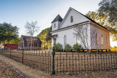 Old church and homes in the historic landmark park near Dothan, Alabama