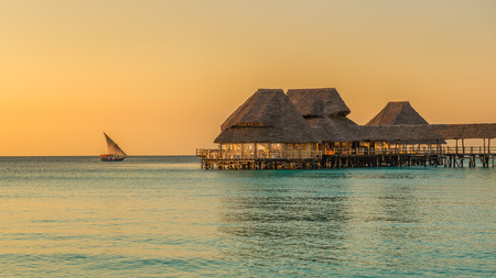 Bar and cafe on water at sunset in Zanzibar, Tanzania 免版税图像