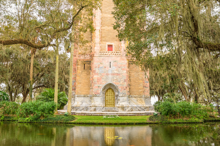 bird sanctuary: The Singing Tower with its ornate brass door in Lake Wales, Florida. Bok Tower Gardens  is a National Historic Landmark  and a bird sanctuary located north of Lake Wales. Stock Photo