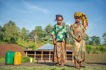 ADDIS ABBABA, ETHIOPIA - MAY 1, 2015 : Two ethiopian girls going for water near Addis Ababa.