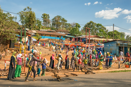 addis: ADDIS ABBABA ETHIOPIA  MAY 1 2015 : Popular and crowded african market near Addis Abbaba Ethiopia with many  people buying and selling.