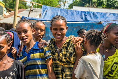 underdeveloped: JIMMA, ETHIOPIA - MAY 2, 2015 : Young ethiopian girls at a popular local market  in Jimma. Editorial