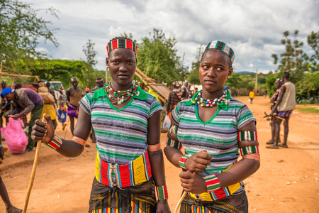 aboriginal woman: TURMI, OMO VALLEY, ETHIOPIA - MAY 5, 2015: Two girls from the Hamar tribe with traditional jewelry at a popular local market.