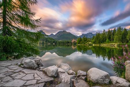 lake sunset: Glacial mountain lake Strbske Pleso in National Park High Tatra, Slovakia. Long exposure.