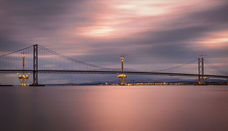 forth: Forth Road Bridge and the Queensferry Crossing under construction in Edinburgh, Scotland, United Kingdom. Long exposure.