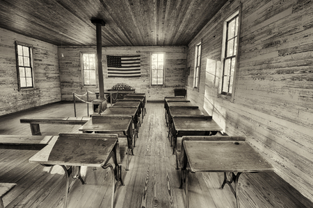 schooldesk: DOTHAN, ALABAMA - JANUARY 17, 2015 :  Interior of the historic one-room School in the Dothans Landmark Park. HDR processed.