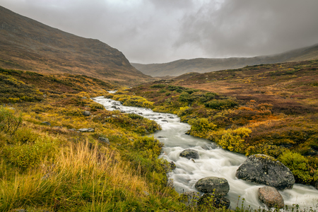 mountain pass: Creek in the Mountain pass over Sognefjellet providing access to Jotunheimen and Jostedalsbreen National Parks, Norway Stock Photo