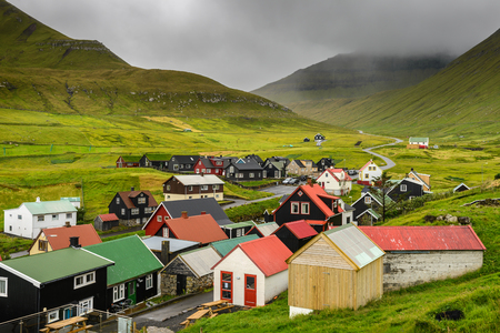 island: Picturesque village of Gjogv with typically colourful houses on the island of Eysturoy, Faroe Islands, Denmark